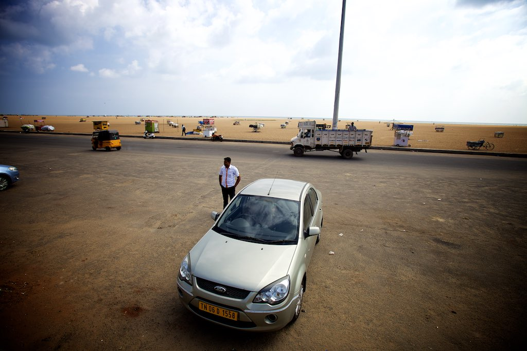 My driver (Esakki) standing in front of the Bay of Bengal. Chennai has the second largest beach in the world, behind Miami